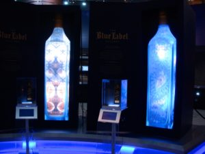 Works by Anrika Rupp (l) and Coral Morphologic (r) in the JOHNNIE WALKER BLUE LABEL Gallery in Miami International Airport