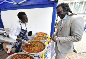 dennis-brown-serves-tv-chef-levi-roots-at-the-caribbean-food-festival-280504543