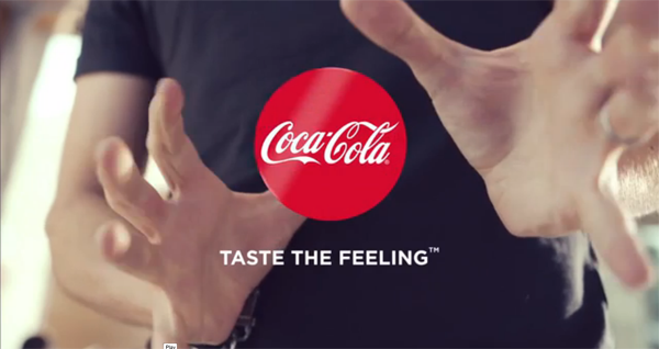 coca cola introduces subtle new packaging using actual magic in ad